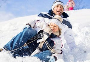 father and son on a sled
